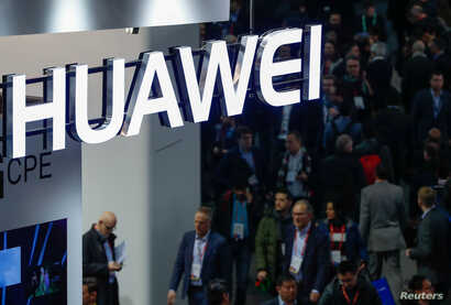 FILE - A logo of Huawei is seen during the Mobile World Congress in Barcelona, Spain.