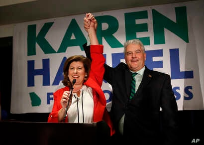 Republican candidate for Georgia's 6th District Congressional seat Karen Handel celebrates with her husband Steve as she declares victory during an election-night watch party, June 20, 2017, in Atlanta.