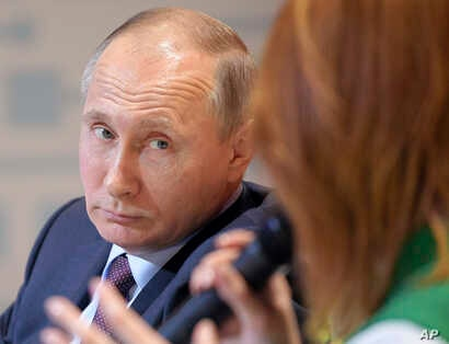 Russian President Vladimir Putin is pictured during his participation in the 6th All-Russian Forum of Working Youth in Nizhny Tagil, Sverdlovsk region, Russia, March 6, 2018.
