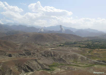 Smokes rises after U.S airstrike hit the site of insurgent activity in Nangarhar province, Afghanistan, July 7, 2018.