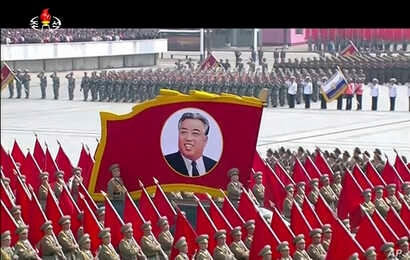 In this image made from video broadcast by North Korean broadcaster KRT, a portrait of the country's founder, Kim Il Sung, is carried during a parade at Kim Il Sung Square in Pyongyang, April 15, 2017.