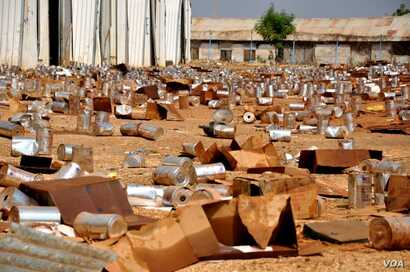 Empty tins litter the ground at the looted compound of an aid agency in Malakal, South Sudan.