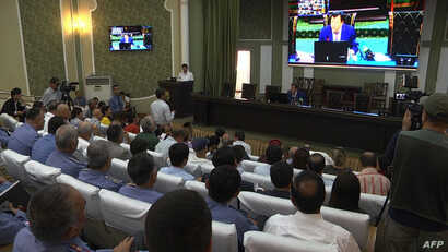 This image grab taken from an AFPTV video shows a general view of a news conference led by Tajik Minister of the Interior Ramazon Hamro Rahimzoda in Dushanbe, July 30, 2018.
