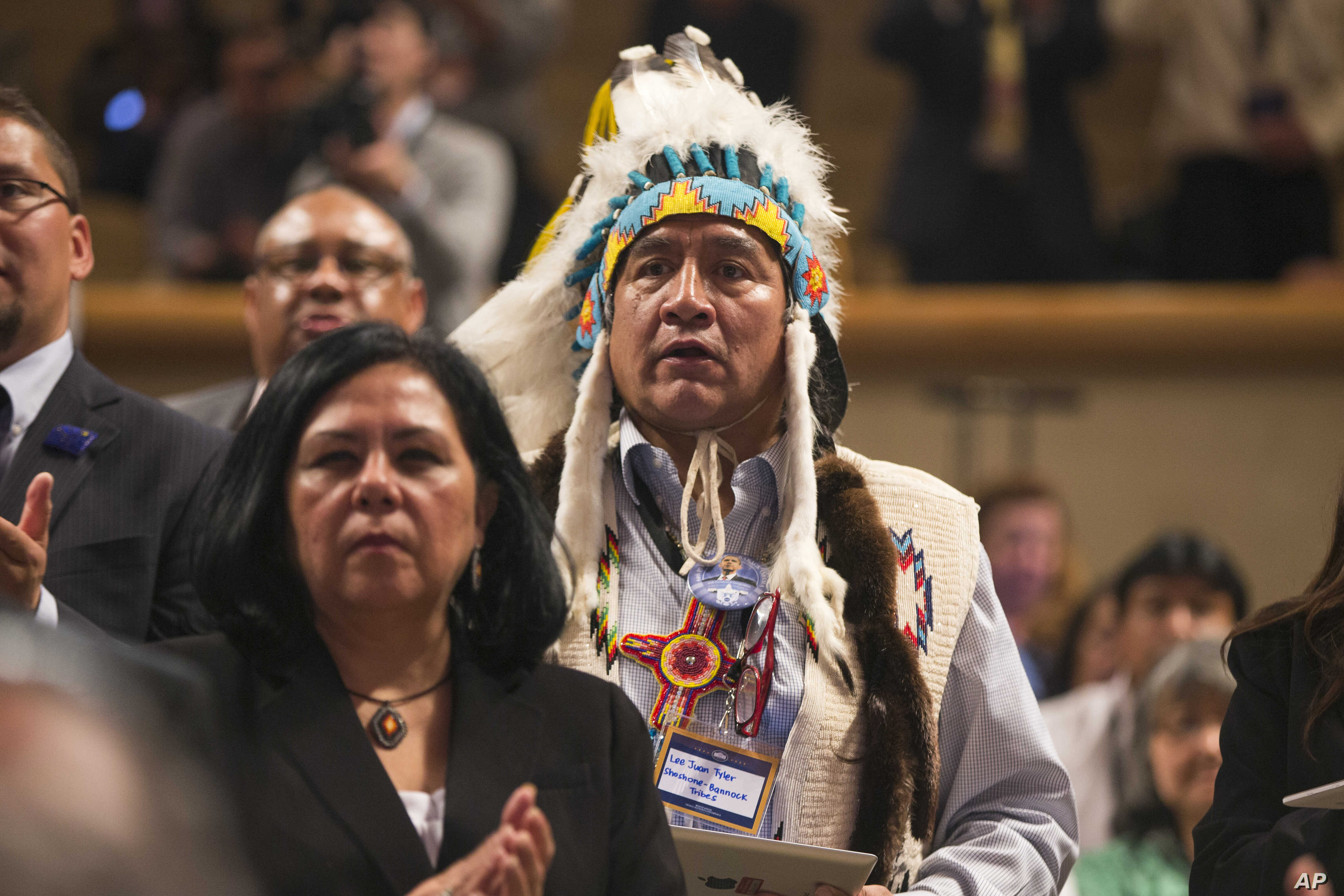 Lee Juan Tyler of Idaho and other audience members wait for the arrival of President Barack Obama to speak at the 2015 White House Tribal Nations Conference, Nov. 5, 2015.