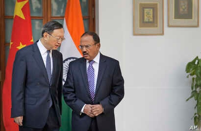 Indian National Security Adviser Ajit Doval (R) talks with Chinese State Councillor Yang Jiechi before their delegation-level meeting in New Delhi, India, Dec. 22, 2017.