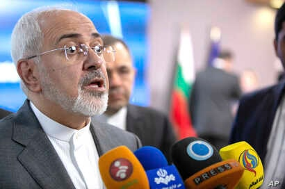 Iranian Foreign Minister Javad Zarif speaks with the media after a meeting with European Union foreign policy chief Federica Mogherini at the Europa building in Brussels, May 15, 2018.