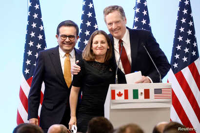 Mexican Economy Minister Ildefonso Guajardo, Canadian Foreign Minister Chrystia Freeland and U.S. Trade Representative Robert Lighthizer smile during a joint news conference on the closing of the seventh round of NAFTA talks in Mexico City, Mexico, M...