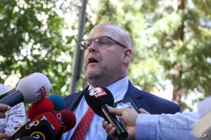 U.S. Charge d'Affaires Jeffrey Hovenier talks to members of the media after visiting US pastor Andrew Brunson, who is being held under house arrest in Izmir, Turkey, Aug. 14, 2018.
