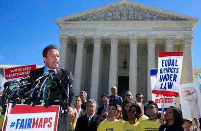 Former California Gov. Arnold Schwarzenegger speaks at a rally outside the U.S. Supreme Court in Washington, Oct. 3, 2017. The Supreme Court heard arguments in a case about political maps in Wisconsin that could affect elections across the country.