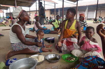 People displaced by flooding are seen at Bangula evucuation camp, in Nsanje, Malawi.