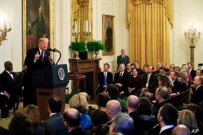 President Donald Trump speaks during a presentation ceremony of the Presidential Medal of Freedom in the East Room of the White House, in Washington, Friday, Nov. 16, 2018. Attending the ceremony are U.S. Supreme Curt Justices, back left to right, Br...