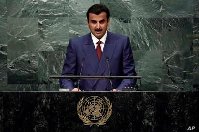 FILE - Emir of Qatar Sheikh Tamim bin Hamad Al-Thani addresses the United Nations General Assembly, Sept. 20, 2016, in New York.