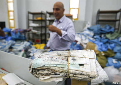 A picture taken on Aug. 14, 2018 shows a stack stack of letters and postcards, among many items of previously undelivered mail dating as far back as 2010 which has been withheld by Israel.