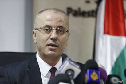 Palestinian Prime Minister Rami Hamdallah speaks during a press conference in the West Bank city of Ramallah, Monday, Jan. 16, 2017.