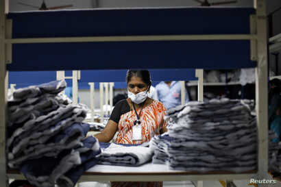 An employee sorts pieces of cloth at the Estee garment factory in Tirupur, in the southern Indian state of Tamil Nadu, June 19, 2013.