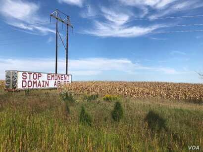 A Stop Eminent Domain Abuse sign is posted along a major highway near Iowa's capital of Des Moines, Sept. 9, 2018. Several Iowans say eminent domain was illegally granted in order for the controversial Dakota Access Pipeline to be installed.