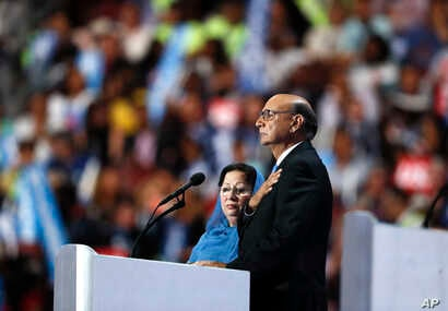 Khizr Khan, father of fallen US Army Capt. Humayun S. M. Khan, speaks while his wife Ghazala Khan looks on, during the final day of the Democratic National Convention in Philadelphia, Thursday, July 28, 2016.