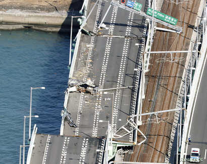 A bridge connecting Kansai airport, damaged by a 2,591-ton tanker, which struck it in strong winds caused by Typhoon Jebi, in Izumisano, Japan, Sept. 5, 2018.