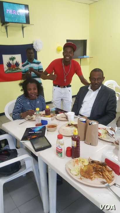 Pierre Lumps Benoit, in red, met with Haiti's ambassador to Mexico, Guy Lamothe, at right, over lunch in Mexicali this summer. (Courtesy photo)