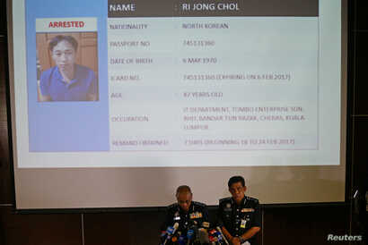 Malaysia's National Police Deputy Inspector-General Noor Rashid Ibrahim (front left) speaks in front of a screen showing detained North Korean Ri Jong Chol during a news conference regarding the apparent assassination of Kim Jong Nam.