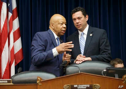 House Oversight and Government Reform Committee Chairman Rep. Jason Chaffetz, R-Utah, right, confers with the committee's ranking member Rep. Elijah Cummings, D-Md., on Capitol Hill in Washington, July 7, 2016, prior to hearing testimony from FBI Dir...