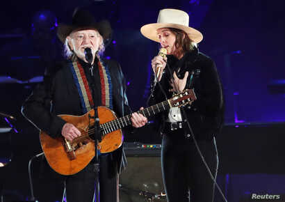 Willie Nelson and Brandi Carlile perform during a gala event honoring Dolly Parton as the MusiCares person of the year, ahead of the Grammy Awards, in Los Angeles, Feb. 8, 2019.