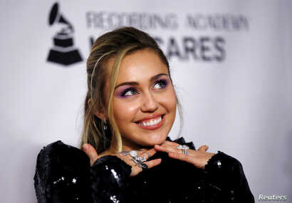 Singer Miley Cyrus attends a red carpet gala event honoring Dolly Parton as the MusiCares person of the year, ahead of the Grammy Awards, in Los Angeles, Feb. 8, 2019.