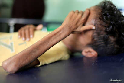 Malnourished Ghazi Ahmad, 10, lies on a bed at a hospital in Taiz, Yemen, Oct. 30, 2018.