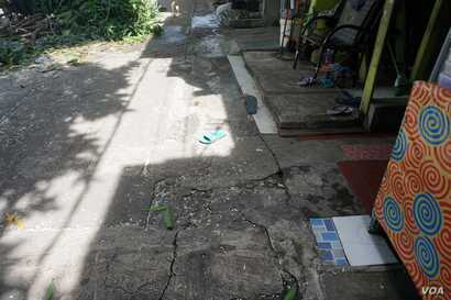 Tiles end abruptly where residents had to shave five meters off the fronts of their homes in Kampung Tongkol, Indonesia.