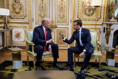 President Donald Trump, right, meets with French President Emmanuel Macron inside the Elysee Palace in Paris, Nov. 10, 2018.