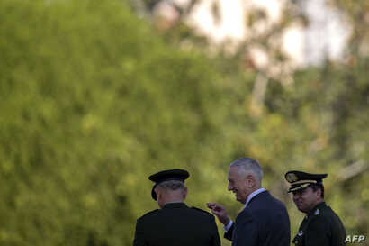 U.S. Defense Secretary Jim Mattis, center, is pictured during a visit to the WWII Veteran's Monument in Rio de Janeiro, Brazil on August 14, 2018.