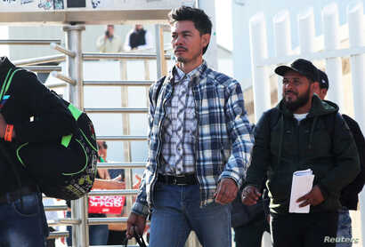 Central American asylum seekers exit the Chaparral border crossing gate after being sent back to Mexico by the U.S. in Tijuana, Mexico, Jan. 30, 2019.
