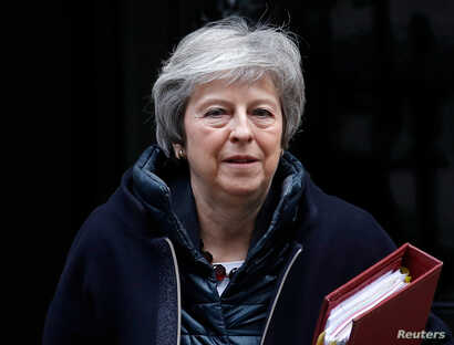 Britain's Prime Minister Theresa May leaves 10 Downing Street in London, Britain, Nov 21, 2018.