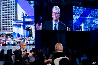 Apple CEO Tim Cook, lower left, speaks at the Bloomberg Global Business Forum, Sept. 20, 2017, in New York.