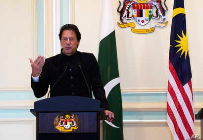 FILE - Pakistan's Prime Minister Imran Khan speaks during a press conference in Putrajaya, Malaysia, Nov. 21, 2018.
