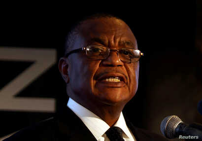 FILE PHOTO: Zimbabwe's Vice-President Constantino Chiwenga speaks at a mining investment conference in Harare, Zimbabwe, Feb. 28, 2018.