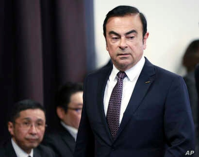 FILE - In this May 12, 2016, file photo, then Nissan Motor Co. President and CEO Carlos Ghosn arrives for a joint press conference with Mitsubishi Motors Corp. in Yokohama, near Tokyo.