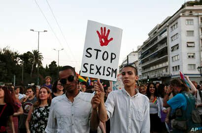 Protesters hold a banner during an annual gay-pride parade in Athens, Greece, June 11, 2016.