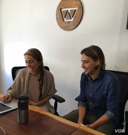 Chase Adam and Grace Garey review patient data at Watsi's office in San Francisco. (Photo: J. Sluizer)