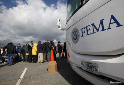 People wait in line to meet with FEMA officials in Coney Island, New York, Nov. 2, 2012, Four days after Sandy smashed into the Northeast.