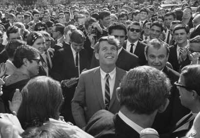 FILE - In this June 7, 1966, file photo Sen. Robert F. Kennedy is surrounded by students and newsmen as he tours Stellenbosch, South Africa, during a five-day visit to South Africa as the guest of the multiracial National Union of South African stude...