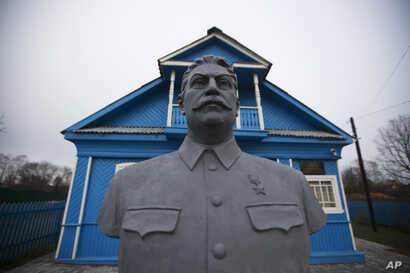 FILE - A bust of Soviet leader Josef Stalin stands on the front lawn of a house-turned-museum in the village of Khoroshevo, west of Moscow, Russia, Dec. 9, 2015. The Stalin museum was opened this year in this small village where the Soviet leader is ...