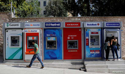 FILE - A row of ATMs in Istanbul, Turkey, September 12, 2017.