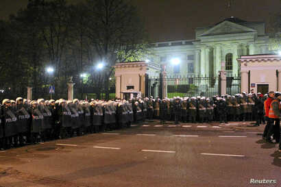 Riot police form a cordon in front of the Russian embassy during the annual far-right march, which coincides with Poland's national Independence Day, in Warsaw, Nov. 11, 2013.