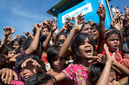 Rohingya refugee children shout slogans during a protest against the repatriation process at Unchiprang refugee camp near Cox's Bazar, in Bangladesh, Nov. 15, 2018.