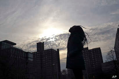 A survivor of sexual assault meditates in the Brooklyn borough of New York on March 14, 2019.