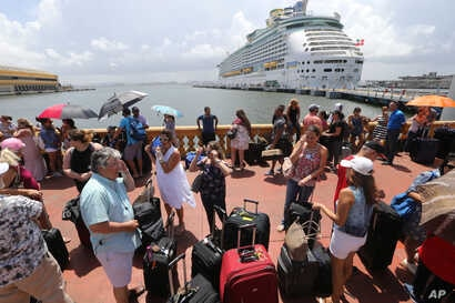 Thousands of people evacuating Puerto Rico line up to get on a cruise ship in the aftermath of Hurricane Maria in San Juan, Puerto Rico, Sept. 28, 2017.