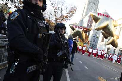 Members of the New York Police Department take a position along the route before the start of the 92nd annual Macy's Thanksgiving Day Parade in New York, Nov. 22, 2018.