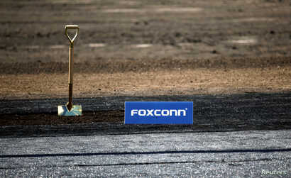 A shovel and FoxConn logo are seen before the arrival of U.S. President Donald Trump as he participates in the Foxconn Technology Group groundbreaking ceremony for its LCD manufacturing campus, in Mount Pleasant, Wisconsin, June 28, 2018.