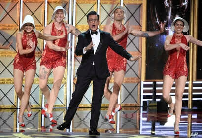 Host Stephen Colbert performs at the 69th Primetime Emmy Awards, Sept. 17, 2017, at the Microsoft Theater in Los Angeles..